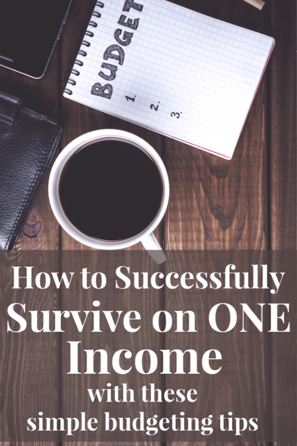 """a wood table with a cup of coffee, a notebook sits next to it with the word""""budget"""" written in bold letters; feature image for budgeting for a large family by forgotten lattes; the text reads how to successfully survive on one income with these simple budgeting tips"""