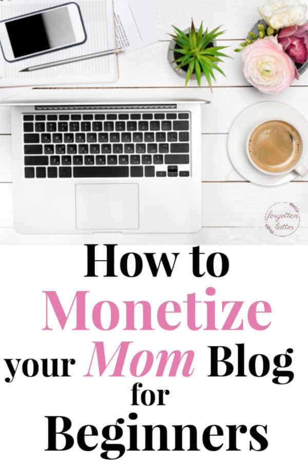"""a flat lay of items on a white wood table; the times are blogger essentials and include an open silver laptop, a smart phone, a small green plant, a cup of coffee, and a pink flower for a pop of color with text below that says """"How to Monetize your mom blog for beginners"""""""