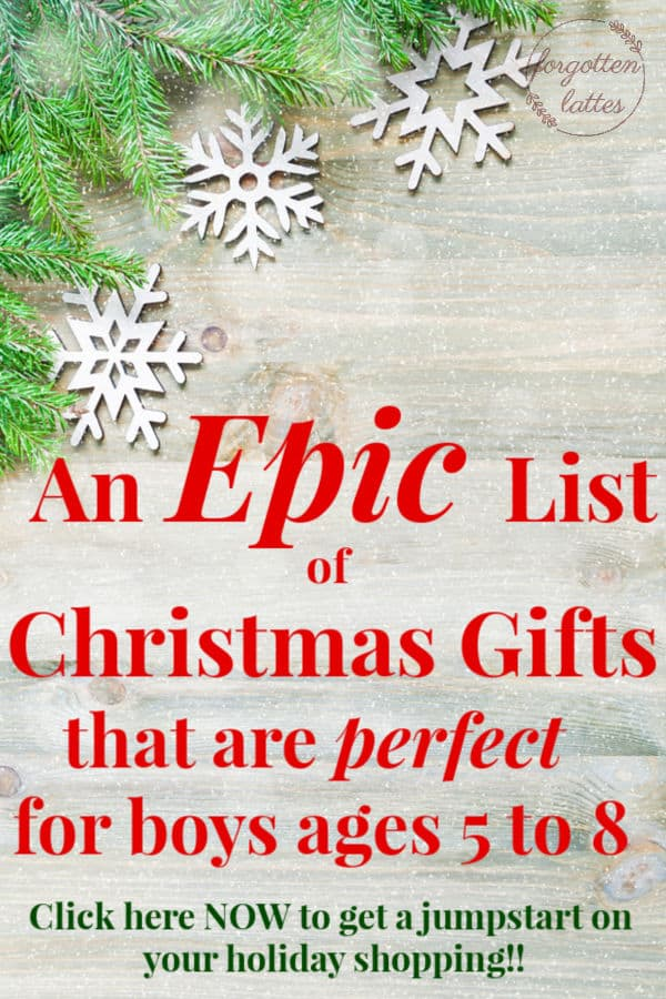 """a gray wooden flat lay with Christmas greenery in the top left corner; white snowflakes lay on the greenery and the text reads """"an epic list of Christmas gifts that are perfect for boys ages 5 to 8"""""""