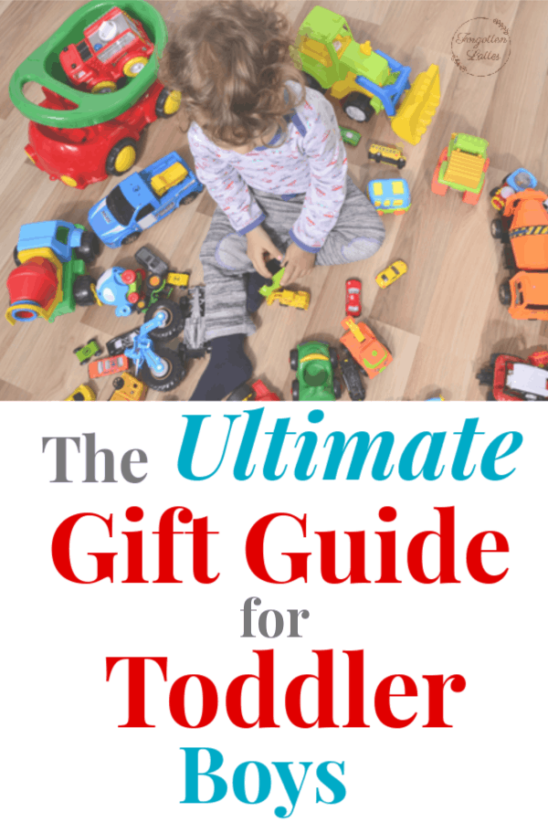 """toddler boys sitting on the floor surrounded by toys, text below the image reads """"The Ultimate Gift Guide for Toddler Boys"""""""