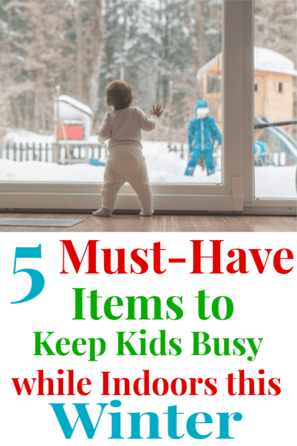 "graphic with an image on top and text on the bottom; image of a young child standing at a window staring outside at another child playing in the snow; the text below reads ""5 Must Have Items to Keep Kids Busy While Indoors This Winter"""