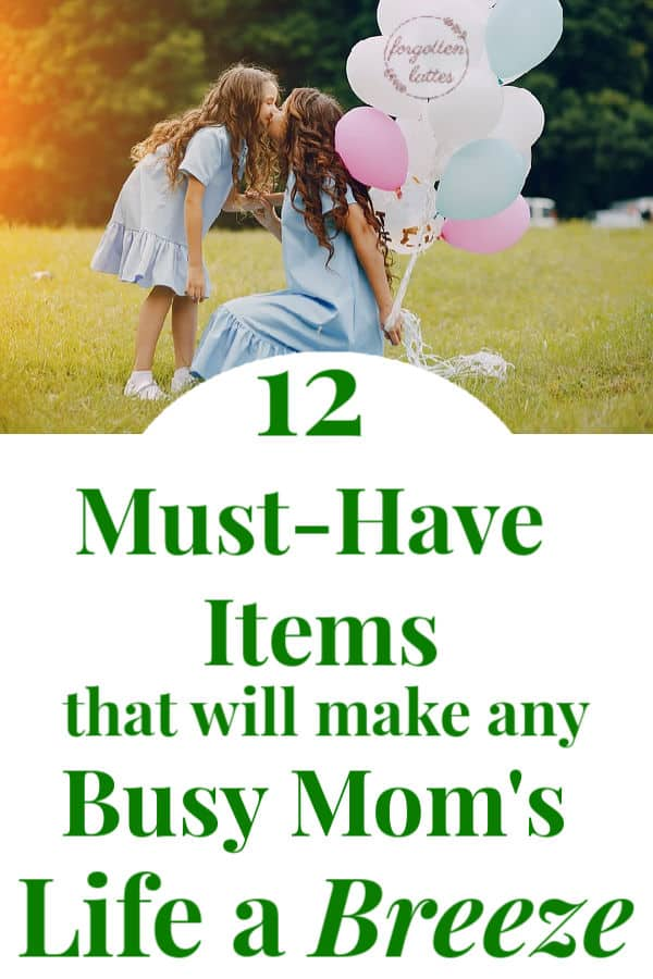 "a mother and daughter are pictured, both are wearing blue dresses, the mom is kneeling down, the young daughter is bending down to kiss her mother on the lips, mom is holding blue white and pink balloons; they are outside in the grass with trees behind them; busy moms; text below the photo reads ""12 must-have items that will make any busy mom's life a breeze"""
