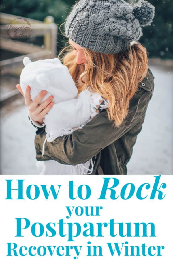 "a blonde woman wearing a grey winter hat holding her baby dressed in a white snow suit, they stand outside in the snow with evergreen trees and a wood fence behind them; text below the photo reads ""how to rock your postpartum recovery in winter"""