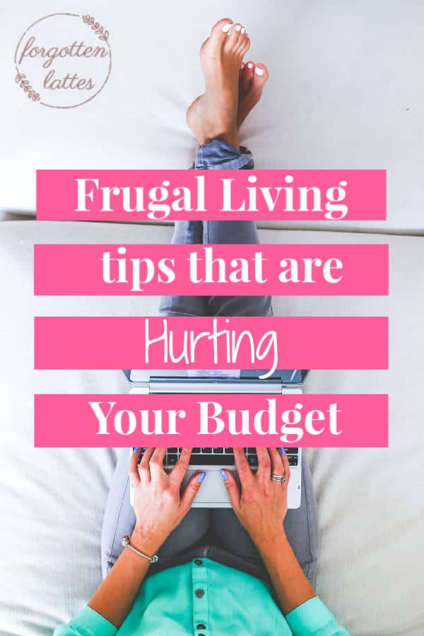 "a woman wearing jeans a green sweater, is sitting barefoot on her bed, holding a silver laptop on her lap, typing updates to her budget;  the text overlay reads ""Frugal Living tips that are Hurting your budget"""