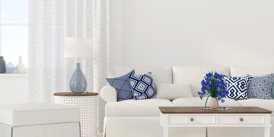 "Interior of the living room in white and blue color; feature image for the article titled ""how to declutter your home when you feel overwhelmed"" by the parenting blog Forgotten Lattes"