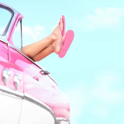 Closeup on legs of young woman in a car, she is ready to driver after her c section